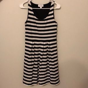 Black and white striped cocktail dress.